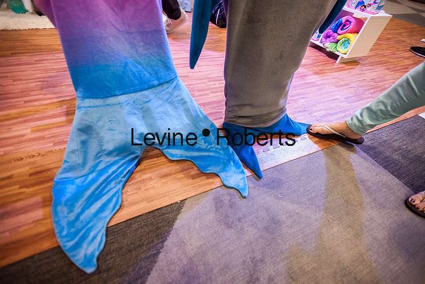 You can be a mermaid or a shark with Blankie Tails' blankets displayed at the 114th North American International Toy Fair in the Jacob Javits Convention center in New York on Sunday, February 19, 2017.  The four day trade show with over 1000 exhibitors connects buyers and sellers and draws tens of thousands of attendees.  The toy industry generates over $26 billion in the U.S. alone and Toy Fair is the largest toy trade show in the Western Hemisphere. (© Richard B. Levine)