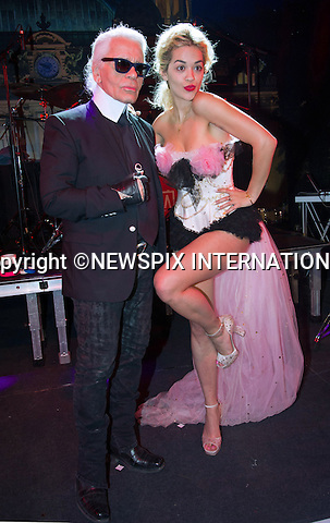 """KARL LAGERFELD AND RITA ORA.attend one of the Principality's premiere event the """"Bal de la Rose Du Rocher"""" (Monaco Rose Ball)..The event celebrating the 150th Anniversary of the SBM was in aid of the Fondation Princess Grace and was held at the Sporting Monte-Carlo_23/3/2013.Royals attending the event included Prince Albert, Princess Charlene, Princess Caroline (who became a Grand-mother last week), Charlotte Casiraghi and boyfriend Gad Elmaleh, Pierre Casiraghi and girlfriend Beatrice Borromeo..Mandatory Credit Photos: ©Monte-Carlo SBM/Pierre Villard/NEWSPIX INTERNATIONAL..**ALL FEES PAYABLE TO: """"NEWSPIX INTERNATIONAL""""**..PHOTO CREDIT MANDATORY!!: NEWSPIX INTERNATIONAL(Failure to credit will incur a surcharge of 100% of reproduction fees)..IMMEDIATE CONFIRMATION OF USAGE REQUIRED:.Newspix International, 31 Chinnery Hill, Bishop's Stortford, ENGLAND CM23 3PS.Tel:+441279 324672  ; Fax: +441279656877.Mobile:  0777568 1153.e-mail: info@newspixinternational.co.uk"""
