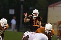 01 APRIL 2006: University of Texas freshman quarterback hopeful, Colt McCoy (center), audibles prior to running a play at Darrell K. Royal Memorial Stadium during the Longhorns annual spring Orange vs White Scrimmage.