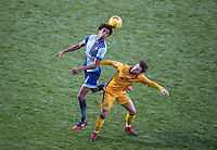 Sido Jombati of Wycombe Wanderers heads clear of Josh Sheehan of Newport County during the Sky Bet League 2 match between Wycombe Wanderers and Newport County at Adams Park, High Wycombe, England on 2 January 2017. Photo by Andy Rowland.