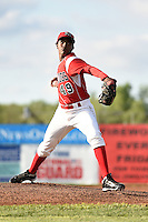 Batavia Muckdogs pitcher Jose Adames (49) delivers a warmup pitch during a game against the Auburn Doubledays on June 14, 2014 at Dwyer Stadium in Batavia, New York.  Batavia defeated Auburn 7-2.  (Mike Janes/Four Seam Images)