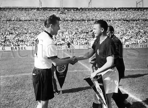 World Cup Finals, Basle, Switzerlsnd. Captain Ferenc Puskas of Hungary (r) and  Fritz Walter of Germany exchange  pre-game pennants on 20.6.1954 before the footballl world cup championship in Basel. Hungary defeated Germany by a score of  8:2.
