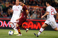 Calcio, Serie A: Roma vs Milan. Roma, stadio Olimpico, 25 aprile 2014.<br /> AS Roma midfielder Miralem Pjanic, of Bosnia, center, prepares to score as AC Milan defenders Philippe Mexes, of France, left, and Daniele Bonera try yo stop him during the Italian Serie A football match between AS Roma and AC Milan at Rome's Olympic stadium, 25 April 2014.<br /> UPDATE IMAGES PRESS/Riccardo De Luca