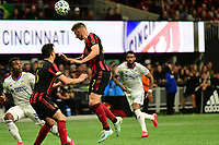 ATLANTA, GA - MARCH 07: ATLANTA, GA - MARCH 07: Atlanta United defender Laurence Wyke heads the ball clear during the match against FC Cincinnati, which Atlanta won, 2-1, in front of a crowd of 69,301 at Mercedes-Benz Stadium during a game between FC Cincinnati and Atlanta United FC at Mercedes-Benz Stadium on March 07, 2020 in Atlanta, Georgia.