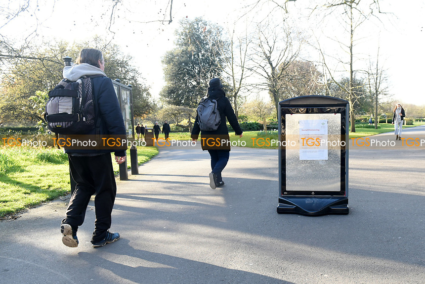 A social distancing sign in Regents Park. The deserted streets show the severe effects of the COVID-19 epidemic on London on 23rd March 2020