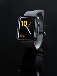 Apple Watch series 2 smartwatch with analog clock dial on display isolated on black background