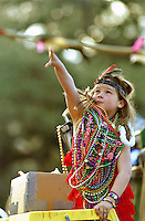 A young Mardi Gras girl reaches to catch beads thrown from the Endymion Float on February 14, 2002 on St. Charles Avenue in New Orleans, LA.