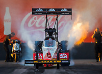 Feb 3, 2017; Chandler, AZ, USA; NHRA top fuel dragster driver Doug Kalitta does a burnout during Nitro Spring Training preseason testing at Wild Horse Pass Motorsports Park. Mandatory Credit: Mark J. Rebilas-USA TODAY Sports