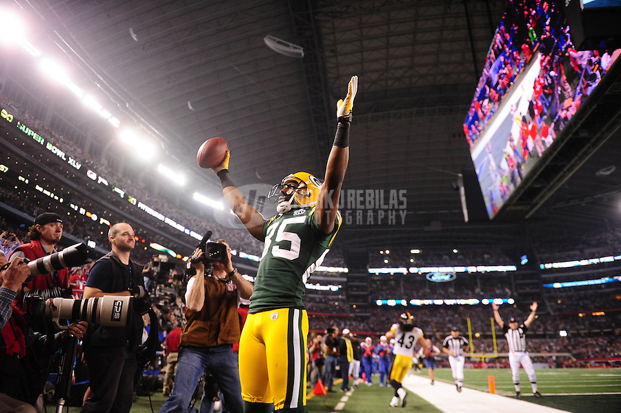Feb 6, 2011; Arlington, TX, USA; Green Bay Packers wide receiver Greg Jennings (85) scores a touchdown during the second half of Super Bowl XLV against the Pittsburgh Steelers at Cowboys Stadium.  Mandatory Credit: Mark J. Rebilas-