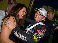 Nov 16, 2014; Pomona, CA, USA; NHRA pro stock driver Erica Enders-Stevens (right) celebrates with sister Courtney Enders after clinching the 2014 pro stock championship and winning the Auto Club Finals at Auto Club Raceway at Pomona. Mandatory Credit: Mark J. Rebilas-USA TODAY Sports