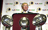 Joe Gibbs and the 3 Super Bowl trophys he won in the 1980s and 1990s as head coach of the Washington Redskins during the press conference at Redskin Park in Ashburn, Virginia on January 8, 2004 after being named again head coach of the Washington Redskins.  Gibbs previously worked as the head coach of the Redskins from 1981 through 1992.