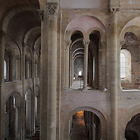 Galleries on the North side of the nave, and nave on the left, seen from the gallery, in the Abbatiale Sainte-Foy de Conques or Abbey-church of Saint-Foy, Conques, Aveyron, Midi-Pyrenees, France, a Romanesque abbey church begun 1050 under abbot Odolric to house the remains of St Foy, a 4th century female martyr. The 20.7m high nave is barrel-vaulted and supported by columns and arches along each side. The church is on the pilgrimage route to Santiago da Compostela, and is listed as a historic monument and a UNESCO World Heritage Site. Picture by Manuel Cohen