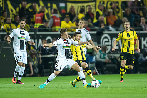 23.09.2016. Dortmund, Germany. German Bundesliga Football. Borussia Dortmund versus SC Freibrug.  Amir Abrashi (SC Freiburg 6) Gonzalo Castro (Borussia Dortmund 27)