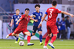 Nguyen Huy Hung of Vietnam (L) fights for the ball with Minamino Takumi of Japan (C) during the AFC Asian Cup UAE 2019 Quarter Finals match between Vietnam (VIE) and Japan (JPN) at Al Maktoum Stadium on 24 January 2018 in Dubai, United Arab Emirates. Photo by Marcio Rodrigo Machado / Power Sport Images