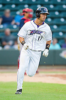 Rangel Ravelo (17) of the Winston-Salem Dash hustles down the first base line against the Potomac Nationals at BB&T Ballpark on July 8, 2013 in Winston-Salem, North Carolina.  The Dash defeated the Nationals 12-9.  (Brian Westerholt/Four Seam Images)