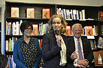 Rockville Centre, New York, USA. April 201, 2018. At center, Nassau County Executive LAURA CURRAN briefly speaks, and L-R, RITA KESTENBAUM and Rep. STEVE ISRAEL smile, at start of special event for Nassau County debut of the former Congressman's (NY - Dem) newest novel BIG GUNS - a satire of the strong gun lobby, weak Congress, and a small Long Island town. Kestenbaum, who was the moderator, is a gun-control activist, non-profit founder, and former Hempstead Town Councilwoman whose daughter was shot to death at college.
