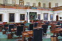Senate, restored 1990-95, with original walnut desks made by A H Andrews for the 31 senators, and window shutters, painted plaster walls and ceiling, carpet and draperies all replicas of the original 1910 fixtures, in the East Wing of the Texas State Capitol, designed in 1881 by Elijah E Myers and built 1882-88, Austin, Texas, USA. The building is in Italian Neo-Renaissance style, with both Corinthian and Doric details and a large central dome. The State Capitol houses the Senate, Governor's Office, House of Representatives and Supreme Court. It is listed on the National Register of Historic Places and is a National Historic Landmark. Picture by Manuel Cohen