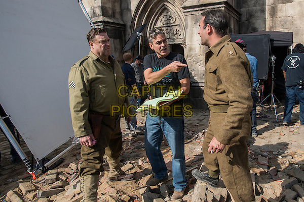 John Goodman, director George Clooney and Jean Dujardin<br /> on the set of The Monuments Men (2014) <br /> *Filmstill - Editorial Use Only*<br /> CAP/FB<br /> Image supplied by Capital Pictures