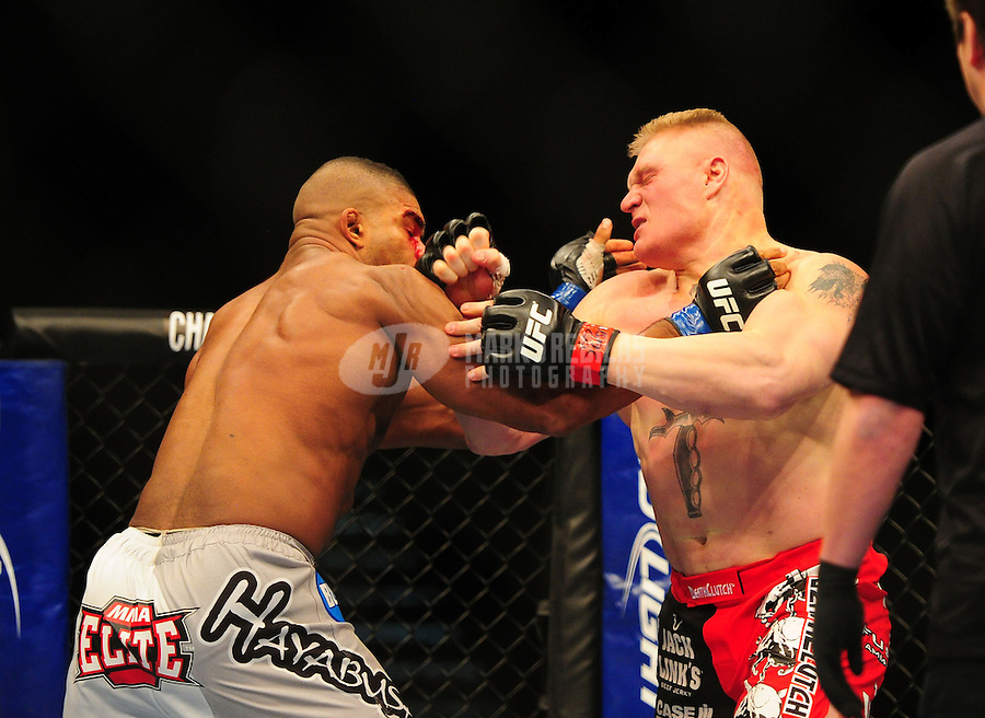 Dec 30, 2011; Las Vegas, NV, USA; UFC fighter Brock Lesnar (right) against Alistair Overeem during a heavyweight bout at UFC 141 at the MGM Grand Garden event center. Mandatory Credit: Mark J. Rebilas-