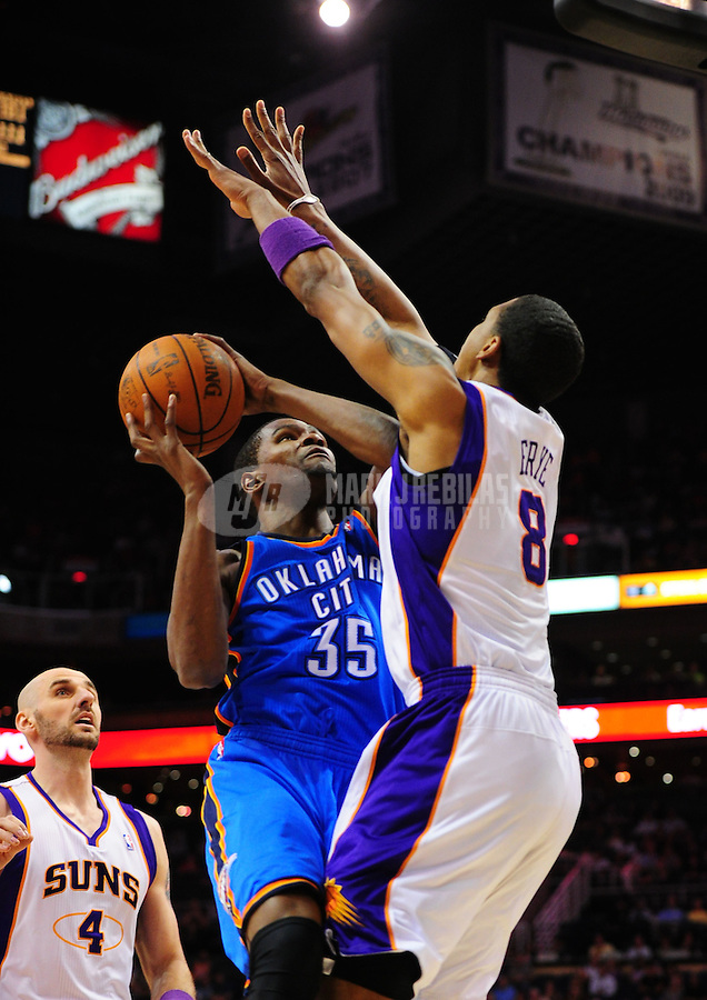 Mar. 30, 2011; Phoenix, AZ, USA; Oklahoma City Thunder forward (35) Kevin Durant drives to the basket in the first half against the Phoenix Suns at the US Airways Center. Mandatory Credit: Mark J. Rebilas-