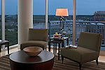 This is a shot of the seating area and the spectacular view from the penthouse living room at dusk. Interior design by Kathy Corbet.