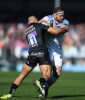 Henry Thomas of Bath Rugby is tackled by Olly Woodburn of Exeter Chiefs. Gallagher Premiership match, between Exeter Chiefs and Bath Rugby on March 24, 2019 at Sandy Park in Exeter, England. Photo by: Patrick Khachfe / Onside Images