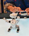June 14, 2012, Tokyo, Japan - Takara Tomys robot dog, the Omnibot I-SODOG, is controlled by a smartphone during a demonstration at at the Tokyo Toy Show on Thursday, June 14, 2012, in Tokyo. ..Controlled by a smartphone, the robot moves like a real dog by utilizing 15 custom-designed servo motors, recognizes voices and responds to hand signals by using build-in motion detection sensors. The largest domestic exhibition of latest toys runs through Sunday, expecting to draw some 150,000 visitors including buyers from overseas. (Photo by Natsuki Sakai/AFLO) AYF -mis-.
