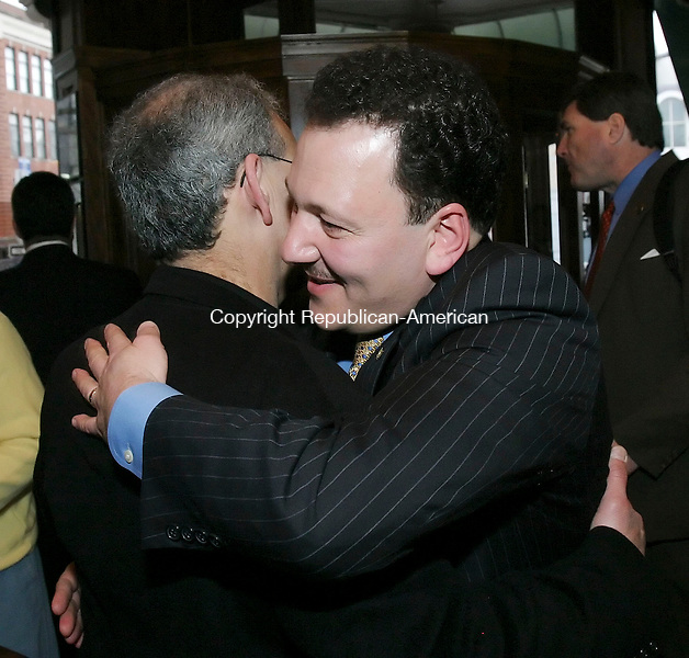 WATERBURY, CT, 03/26/07- 032607BZ03- State Representative Tony D'Amelio, R-71, right, hugs  Anthony Calli, of Waterbury, during a fundraiser for his candidacy for Mayor of Waterbury at the City Hall Cafe Monday night.<br /> Jamison C. Bazinet Republican-American