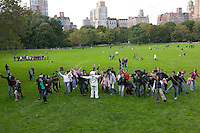 "16 October 2005 - New York City, NY - People following instructions playing on their handheld digital music players space-walk behind Flynn Barrison (astronaut costume, C) across Central Park, New York City, USA, 16 October 2005, during a so-called ""MP3 Experiment"" organized by Improv Everywhere, a group of young artists which seek to organize bizarre, anonymous happenings and pranks."