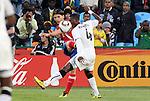 13 JUN 2010: Marko Pantelic (SRB) (9) sends a cross past John Pantsil (GHA) (4). The Serbia National Team lost 0-1 to the Ghana National Team at Loftus Versfeld Stadium in Tshwane/Pretoria, South Africa in a 2010 FIFA World Cup Group D match.