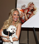 "Kristin Chenoweth with her dog Madeline Kahn ""Maddie"" Chenoweth.attending the after performance reception for.Kristin Chenoweth World Tour directed by Richard Jay Alexander at City Center in New York City on 6/02/2012"