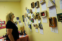 NWA Democrat-Gazette/ FLIP PUTTHOFF<br /> ART AND ICE CREAM<br /> Carla Green looks over art made by church members Saturday June 13 2015 during an ice-cream social fundraiser at Unity Church of the Ozarks in Bentonville. The social had a 1950s theme and raised funds for the church, said Claudia Lawson, church member. Art items made by church members were sold in a silent auction to benefit the church, located at 902 S.W. 2nd St.
