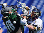 Annapolis, MD: April 5, 2014. Midfielder Josh Trainor #31 of the United States Naval Academy checks the ball out of the stick of midfielder Matt Sawyer # 10 of Loyola University, MD. The Loyola University Greyhounds beat Navy in the second overtime, 7-6 in this Patriot League matchup.<br /> <br /> Photo by Larry French