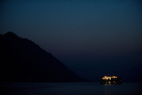 Evening landscape view of a river freighter with running lights on the Cháng Jiāng near the Wànzhōu District in the Chongqing Municipality.  © LAN