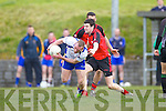 Gary Sayers of Keel is tackled by Tarbert's Ian Flavin last Sunday afternoon in Shannon Park, Tarbert.