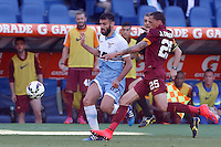 Calcio, Serie A: Lazio vs Roma. Roma, stadio Olimpico, 25 maggio 2015.<br /> Lazio's Antonio Candreva, left, is challenged by Roma's Jose' Holebas during the Italian Serie A football match between Lazio and Roma at Rome's Olympic stadium, 25 May 2015.<br /> UPDATE IMAGES PRESS/Riccardo De Luca