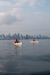 Vancouver, city skyline, Burrard Inlet, British Columbia Canada, women, sea Kayaking, model released, 2002,.