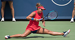 Madison Keys (USA) battles against Garbine Muguruza (ESP) before the rain delay
