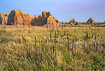 Badlands National Park, South Dakota:<br /> Morning sun on the eroded landforms of the Badlands