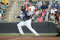 KJ Woods (24) of the Kannapolis Intimidators follows through on his swing against the Delmarva Shorebirds at Kannapolis Intimidators Stadium on June 25, 2016 in Kannapolis, North Carolina.  The Intimidators defeated the Shorebirds 2-1.  (Brian Westerholt/Four Seam Images)