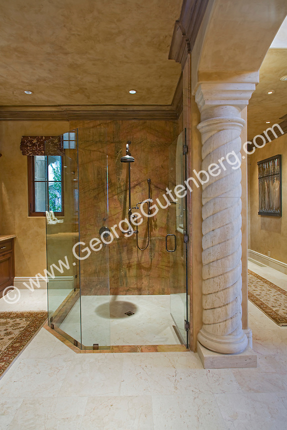 Luxurious master bath showing glass and marble shower and beautiful wooden cabinets Stock photo of master bath, en suite, bathroom