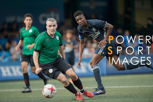 Olympique Marseille (in navy blue) vs Yau Yee League Select (in green), during their Main Tournament match, part of the HKFC Citi Soccer Sevens 2017 on 27 May 2017 at the Hong Kong Football Club, Hong Kong, China. Photo by Marcio Rodrigo Machado / Power Sport Images