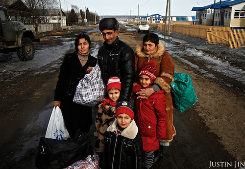 Patvakan Akobian, 33, his wife Satenik Kasarian, 28, with their three children and his mother arrive from Armenia to make their new home in Ushakovo in Russia. Ushakovo, on the Russian side of the border with China, is a development zone where Russia wants to attract Russian-speaking migrants to populate its sparse Far East. Migrants from the former Soviet block are given housing, cattle and a barn to help them start their new life in the Amurskaya Region.