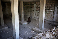 In this Monday, Oct. 07, 2013 photo, an opposition fighter prays instants before to enter into battle at the frontline in Maraat Anouman in the Idlib province countryside of Syria. (AP/Photo)