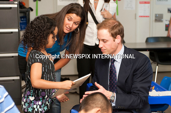 """PRINCE WILLIAM.Prince William on the first day of his tour in Australia visited the City Of Sydney's Redfern Community Centre where he spent time with children aged between 5-12 years old, reading """"Possum Magic"""" to them and playing Nintendo Wii bolwing in which he got a spare.The City Of Sydney's Redfern Community Centre a dynamic inner-city facility that attracts approximetly 4000 people a month and provides a wide range of invaluable services and programs to the local community. Sydney, Australia_19/01/2010.Mandatory Credit Photo: ©DIAS-NEWSPIX INTERNATIONAL..**ALL FEES PAYABLE TO: """"NEWSPIX INTERNATIONAL""""**..IMMEDIATE CONFIRMATION OF USAGE REQUIRED:.Newspix International, 31 Chinnery Hill, Bishop's Stortford, ENGLAND CM23 3PS.Tel:+441279 324672  ; Fax: +441279656877.Mobile:  07775681153.e-mail: info@newspixinternational.co.uk"""