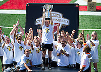 Rachel Buehler holds up the WPS trophy after FC Gold Pride's victory over the Philadelphia Independence 4-0, to capture the 2010 WPS Championships in Hayward, Calif., Sunday, September 26, 2010.
