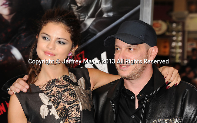WESTWOOD, CA- AUGUST 26: Actress Selena Gomez and director Courtney Solomon arrive at the 'Getaway' - Los Angeles Premiere at Regency Village Theatre on August 26, 2013 in Westwood, California.
