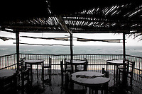 The bar at Papaya Playa and Caribbean Sea during a rainstorm.