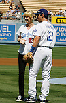 LOS ANGELES, CA. - September 19: Jenna Elfman greets Brad Ausmus after throwing the ceremonial first pitch at the Dodger vs. S.F. Giants  game at Dodger Stadium on September 19, 2009 in Los Angeles, California.