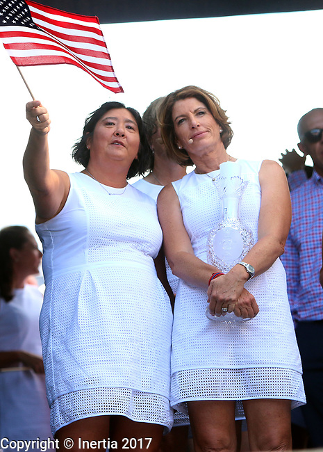 DES MOINES, IA - AUGUST 17: Assistant Captain Wendy Ward waves an American flag next to Captain Juli Inkster holding the Solheim Cup prior to introductions at the opening ceremony at the 2017 Solheim Cup in Des Moines, IA. (Photo by Dave Eggen/Inertia)